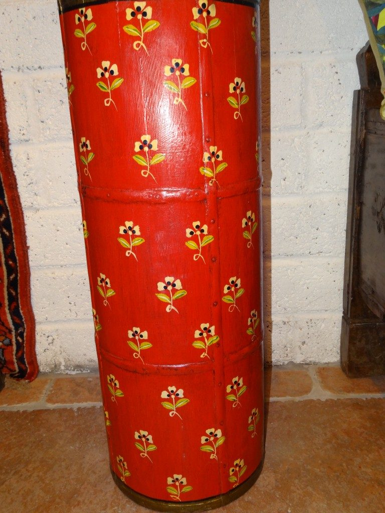 Red hand painted umbrella stand from Rajasthan in India